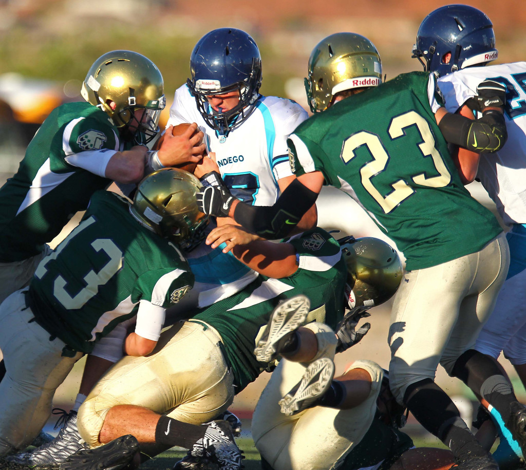 The Warrior defense stacks up the Juan Diego ball carrier, Snow Canyon vs. Juan Diego, Football, St. George, Utah, Sept. 4, 2015, | Photo by Robert Hoppie, ASPpix.com, St. George News