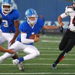 Dixie quarterback Zac Harrah eludes an Alta defender, Dixie vs. Alta, Football, St. George, Utah, Sept. 4, 2015, | Photo by Robert Hoppie, ASPpix.com, St. George News