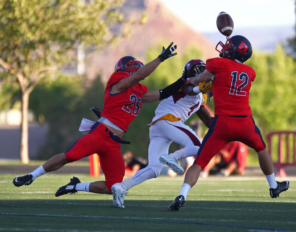 Dixie State defenders Colton Olson (12) and Garret Hutnick (25) break up a pass in this file photo from Dixie State University vs. Colorado Mesa University, Football, St. George, Utah, Sept. 5, 2015, | Photo by Robert Hoppie, ASPpix.com, St. George News