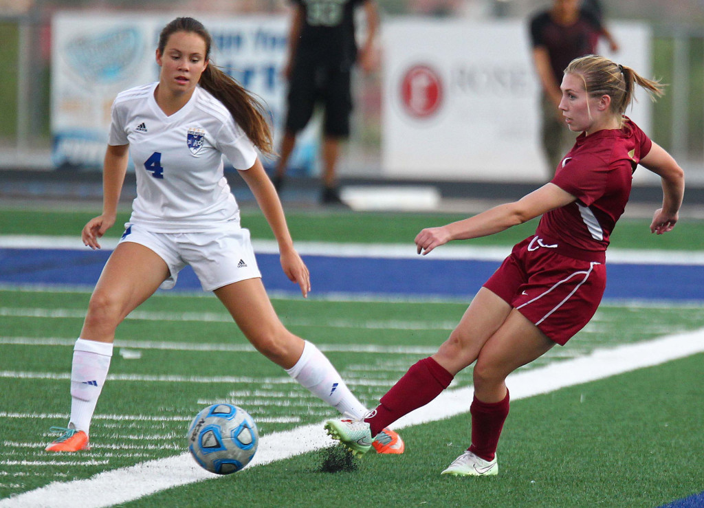 Cedar's Brooklyn Shakespeare and Dixie's McKenna McAllister (4) fight for a loose ball, Dixie vs. Cedar, Girls Soccer, St. George, Utah, Sept. 8, 2015, | Photo by Robert Hoppie, ASPpix.com, St. George News