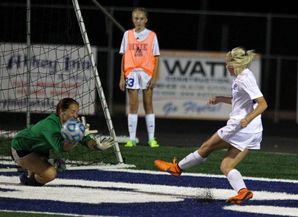 Dixie's Kennedy Warnick puts a shot on goal but is stopped by Cedar goalkeeper Megan Giddings, Dixie vs. Cedar, Girls Soccer, St. George, Utah, Sept. 8, 2015, | Photo by Robert Hoppie, ASPpix.com, St. George News
