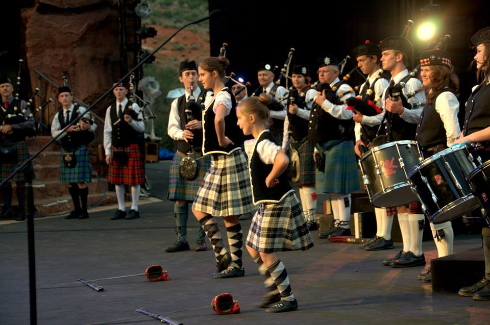 "Photo from ""Our Story Goes On"" performed prior to 2015, with bagpipes and accompanying instruments. Location, date unspecified 