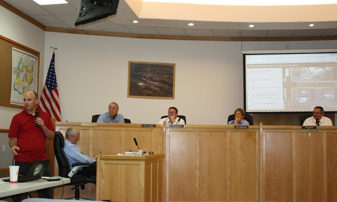 UDOT Project Director Branden Anderson tells the City Council the benefits of inserting a median along the stretch of State Street between 300 West and 700 West, Hurricane, Sept. 3, 2015| Reuben Wadsworth, St. George News