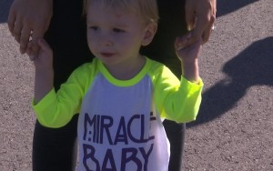 """Kai Wennerlind, a two-year-old """"Miracle Baby"""" made an appearance at the Pound the Pavement for Parenthood 5k event, Confluence Park, St. George, Utah, Sept. 19, 2015 