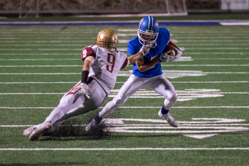 Jaden Harrison makes a move Friday night, Cedar at Dixie, St. George, Utah, Sept. 18, 2015 | Photo by Dave Amodt, St. George News