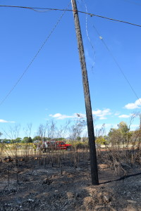 A brush fire badly burned two telephone poles, Enoch, Utah, Sept. 27, 2015 | Photo by Emily Hammer, St. George News
