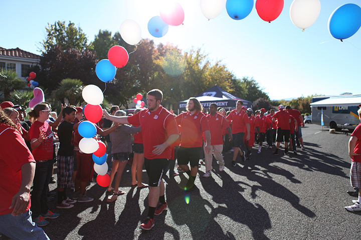 The 2013 Dixie State University football team greets fans during a tailgate party as they head over to Hansen Stadium to play the Homecoming game, date unspecified | Photo courtesy of Dixie State University, St. George News