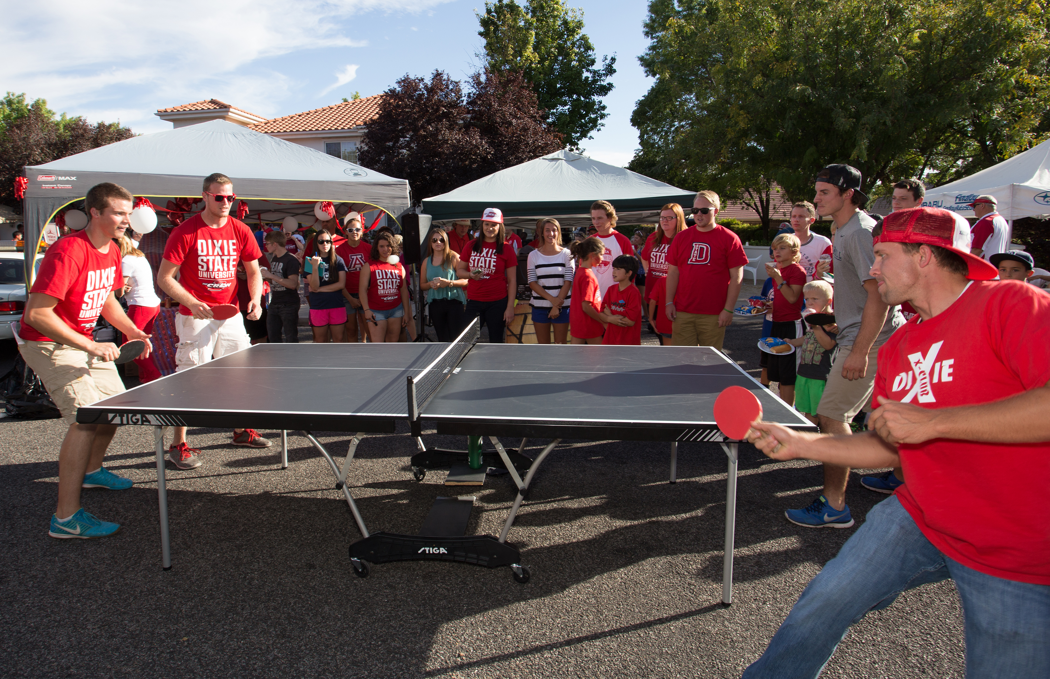 Dixie State University fans play a match of ping pong during the DSU Alumni Association's tailgate party at the Wade Alumni House, St. George, Utah, Sept. 29, 2015 | Photo courtesy of Dixie State University, St. George News