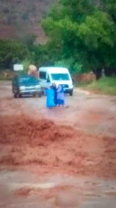A photo taken just moments before the tragic flash flooding unfolded shows three women and their van and SUV, both occupied by their 13 children, as they waited near the widening stream for the water to recede so they could cross, Hildale, Utah, Sept. 14, 2015 | Photo courtesy of John Willis Barlow, St. George News