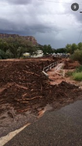 Flash flood debris field crashing against a walkway over a wash, Hildale, Utah, Sept. 14, 2015 | Photo courtesy of Marvin Barlow, St. George News