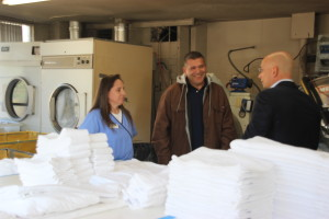 """Travel Channel's """"Hotel Impossible"""" host Anthony Melchiorri meets with employees of the Stratford Court Hotel's housekeeping department, to get more insight into the hotel's operations, Stratford Court Hotel, Cedar City, Utah, March 2014 