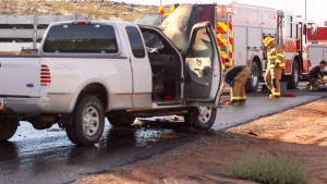 Firefighters douse a natural gas truck that caught fire on Cottonwood Springs Road Tuesday afternoon, St. George, Utah, Sept. 29, 2015   Photo by Julie Applegate, St. George News