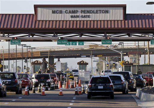 This Nov. 13, 2013, file photo shows the main gate of Camp Pendleton Marine Base at Camp Pendleton, Calif. One Marine was killed and 18 others were injured Thursday afternoon, Sept. 10, 2015, in a vehicle rollover accident on the base. No details about the accident were immediately released, nor were the identities of the dead or injured. AP File Photo by Lenny Ignelzi, St. George News