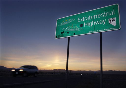 "In this April 10, 2002, file photo, a car moves along the Extraterrestrial Highway near Rachel, Nev, the closest town to Area 51. The U.S. Air Force is giving an ultimatum to owners of the remote Nevada property: Take a $5.2 million ""last best offer"" by Thursday, Sept. 10, 2015, for their property now surrounded by a vast bombing range including the super-secret Area 51, or the government will seize it. 