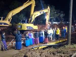 Friends and loved ones lined the street as search and recovery operations continued through Monday night into the next day in the wake of flash flooding that claimed the life of at least 13 women and children in Hildale, Utah, Sept. 15, 2015   Photo by Kimberly Scott, St. George News
