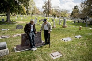 Cousins Merlin Morrison, 80, and John Arling Morrison, 84, talk at the gravesite of their grandparents John G. and Marie Morrison in the Salt Lake City Cemetery. Industrial Workers of the World songwriter Joe Hill was convicted of the Jan. 10, 1914, murder of John Morrison and executed at the Utah State Prison, Salt Lake City Cemetery, April 9, 2015 | AP Photo by Jeremy Harmon, The Salt Lake Tribune JOEHILL.SLTRIB.COM, St. George News