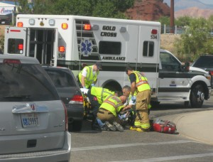 Paramedics and fire department personnel treat a man clipped by a car Saturday afternoon, St. George, Utah, Sept. 5, 2015 | Photo by Ric Wayman, St. George News