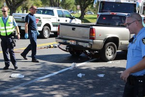 A bicycle is clearly visible under a pickup truck at the scene of an accident across from the cemetery Friday, St. George, Utah, September 25, 2015 | Photo by Ric Wayman, St. George News