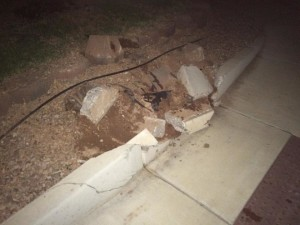 A city curb is heavily damaged in a two-vehicle accident, St. George, Utah, Sept. 29, 2015   Photo by Mori Kessler, St. George News