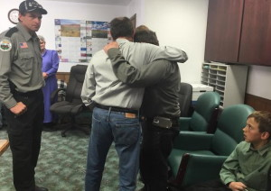 Utah Gov. Gary Herbert embracing Sheldon Black, Jr. (L-R) at the Hildale City Hall. Black lost his wife and two children in Monday's fatal flash flooding. Two of Black's sons survived the flooding, while another, 6-year-old Tyson, remains missing, Hildale, Utah, Sept. 19, 2015 | Photo courtesy of the Office of the Governor St. George News