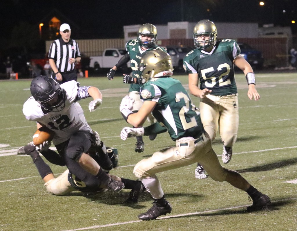 Pine View ball carrier Mason Wiley (12) fights for some tough yards, Snow Canyon vs. Pine View, Football, St. George, Utah, Sept. 18, 2015, | Photo by Kevin Luthy, St. George News