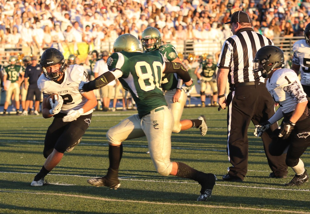 PV's Kobe Topailian (2) and SC's Nick Dolce (80), Snow Canyon vs. Pine View, Football, St. George, Utah, Sept. 18, 2015, | Photo by Kevin Luthy, St. George News