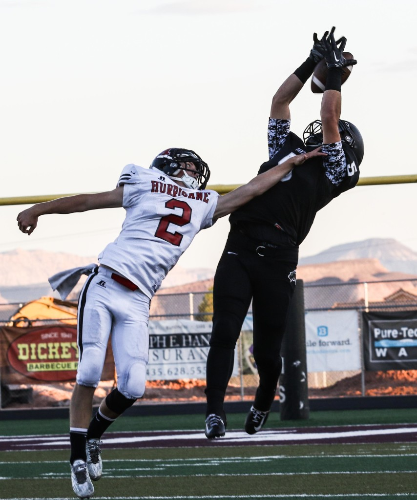 Pine View's Steve Bangerter (5) and Hurricane's Kyle Williams (2), Pine View vs. Hurricane, Football, St. George, Utah, Sept. 25, 2015, | Photo by Kevin Luthy, St. George News