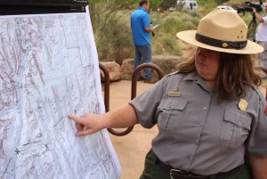 Zion National Park Ranger Aly Baltrus pointing to the location of the Keyhole Canyon during a press conference on the fatal flash flooding incident, Zion National Park, Utah, Spet. 16, 2015 | Photo by Ric Wayman, St. George News
