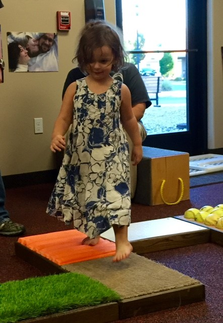 Child enjoys the sensory pathway created by a young men's group for The Learning Center for Families, St. George, Utah, Sept. 23, 2015 | Photo courtesy of The Learning Center for Families, St. George News