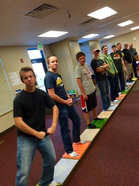 Young men group place together the sensory path for The Learning Center for Families, St. George, Utah, Sept. 23, 2015 | Photo courtesy of The Learning Center for Families, St. George News