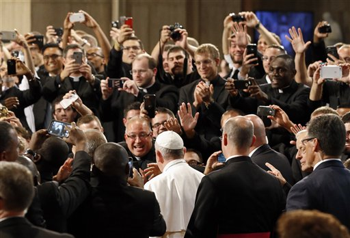 Seminarians greet Pope Francis, bottom center, as he walks into the Basilica of the National Shrine of the Immaculate Conception in Washington, Wednesday, Sept. 23, 2015, before holding a mass to canonize Junipero Serra | Pool Photo via AP, Photo by Tony Gentile, St. George News