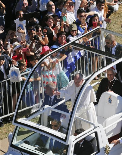 Pope Francis waves from the popemobile as he arrives for the Canonization Mass of Blessed Junipero Serra, Wednesday, Sept. 23, 2015, at the Basilica of the National Shrine of the Immaculate Conception in Washington | AP Photo by Steve Helber, St. George News