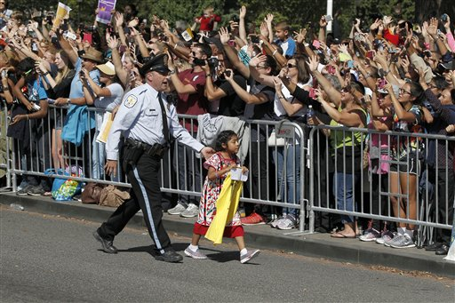A child is escorted back before Pope Francis called for the child to be brought to him, during a parade in Washington, Wednesday, Sept. 23, 2015 | AP Photo by Alex Brandon, Pool, St. George News