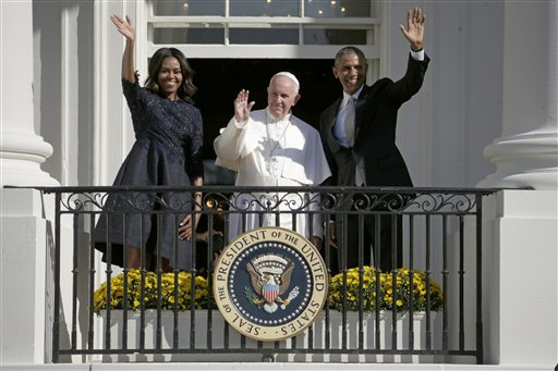 President Barack Obama, first lady Michelle Obama and Pope Francis wave to the crowd on the South Lawn from the Truman Balcony of the White House in Washington, Wednesday, Sept. 23, 2015, during a state arrival ceremony | AP Photo by Pablo Martinez Monsivais, St. George News