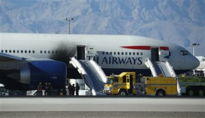 Firefighters enter a plane that caught fire at McCarran International Airport. An engine on the British Airways plane caught fire before takeoff, forcing passengers to escape on emergency slides, Las Vegas, Nevada, Sept. 8, 2015   AP Photo/John Locher, St. George News