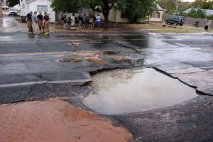 A water main break across from the city cemetery damaged the road Sunday night, St. George, Utah, Sept. 13, 2015 | Photo by Ric Wayman, St. George News