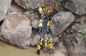 Zion flood-1 Search and rescue team members carry a body after it was found along Pine Creek, Wednesday, Sept. 16, 2015, in Zion National Park, near Springdale, Utah. The final body from the group of seven canyoneers killed in a flash flooding incident in the park was located late Thursday morning, Zion National Park, Utah, Sept. 16, 2015 | AP Photo by Rick Bowmer, St. George News