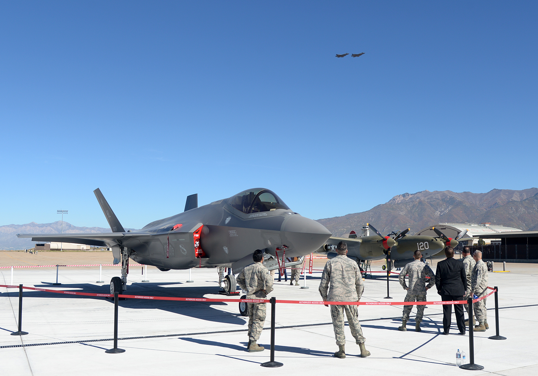 Team Hill personnel watch as two F-35A Lightning II aircraft fly overhead following an F-35 unveiling ceremony at Hill Air Force Base, commemorating the beginning of a new era in combat air power at Hill. The 388th and 419th Fighter Wings at Hill were selected as the first Air Force units to fly combat-coded F-35s. Hill Air Force Base, Utah, Oct. 14, 2015 | U.S. Air Force photo by Alex R. Lloyd, St. George News