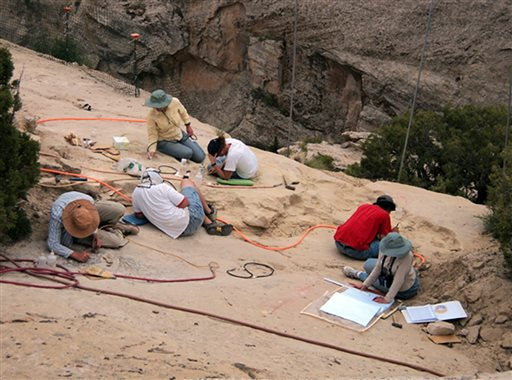 In this undated photo provided by Brigham Young University on Oct. 16, 2015, paleontologists work at a site where a pterosaur, which would have been the largest flying reptile of the time some 210 million years ago, was found in 2009, in Dinosaur National Monument near the town of Jensen in northeastern Utah. Paleontologists have discovered a cliff brimming with fossils that offers a rare glimpse of desert life in western North America early in the age of dinosaurs. | Photo by Brooks Britt, Brigham Young University via AP; St. George News