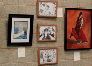 Exploring art contest sumbissions at the new Smithsonian exhibit at the Cedar City Library in the Park, Cedar City, Utah, Oct. 17, 2015   Photo by Carin Miller   St. George News