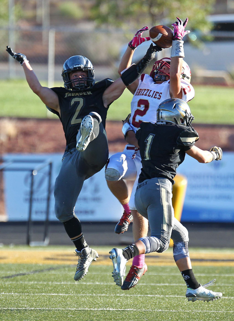 Stetson Wood (2) and Cody Ricketts (1) break up a pass intended for Logan's Spencer Corbett, Desert Hills vs. Logan, Football, St. George, Utah, Oct. 14, 2015, | Photo by Robert Hoppie, ASPpix.com, St. George News