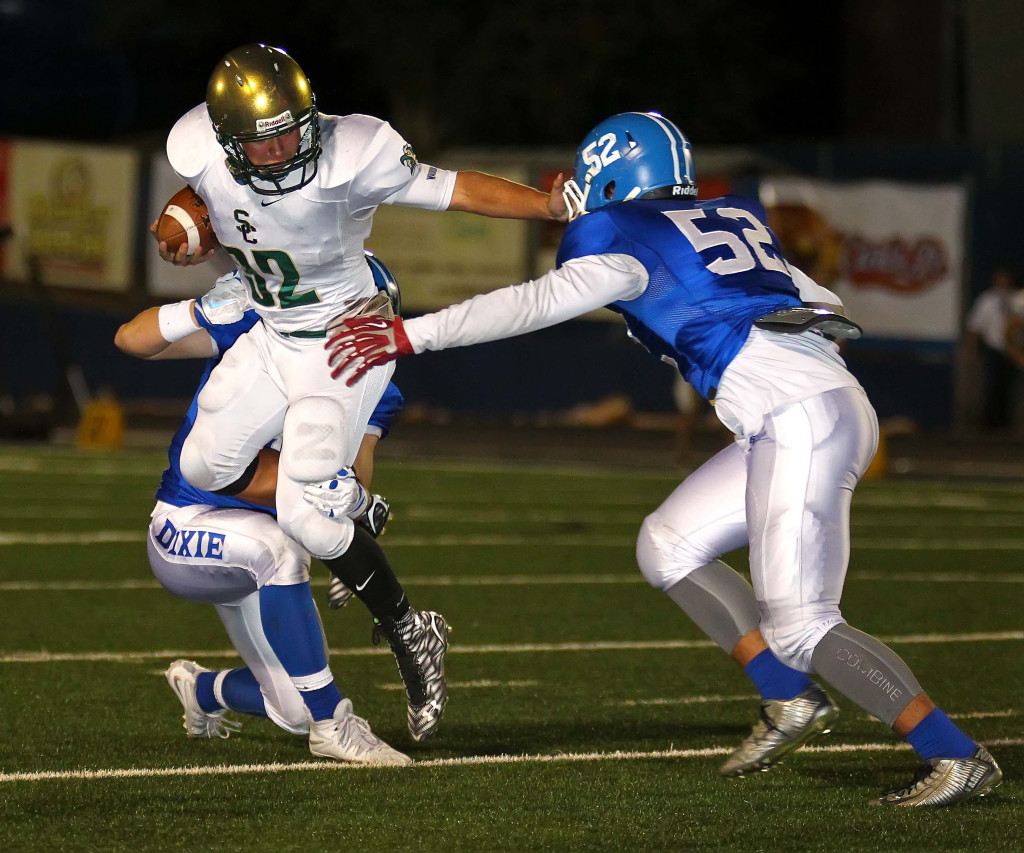 Dixie's Keanu Faumuina (52) makes a tackles in this file photo from Dixie vs. Snow Canyon, Football, St. George, Utah, Oct. 1, 2015, | Photo by Robert Hoppie, ASPpix.com, St. George News