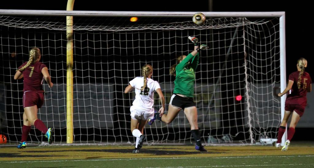 Cedar goalkeeper Megan Giddings just misses a ball that finds the net for a Desert Hills second half goal, Cedar vs. Desert Hills, Girls Soccer, St. George, Utah, Oct. 6, 2015, | Photo by Robert Hoppie, ASPpix.com, St. George News