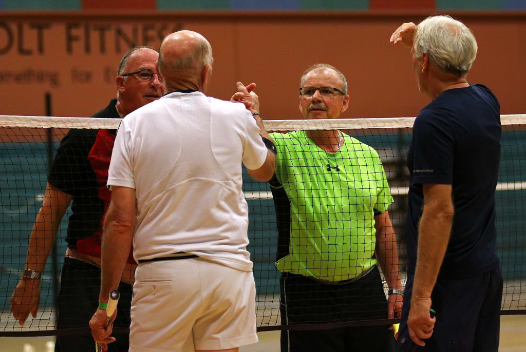 Jerry Mercier (green) and Rick Frost (red) shake hands with their competitors after a match, Huntsman Senior Games, Badminton, St. George, Utah, Oct. 12, 2015, | Photo by Robert Hoppie, ASPpix.com, St. George News