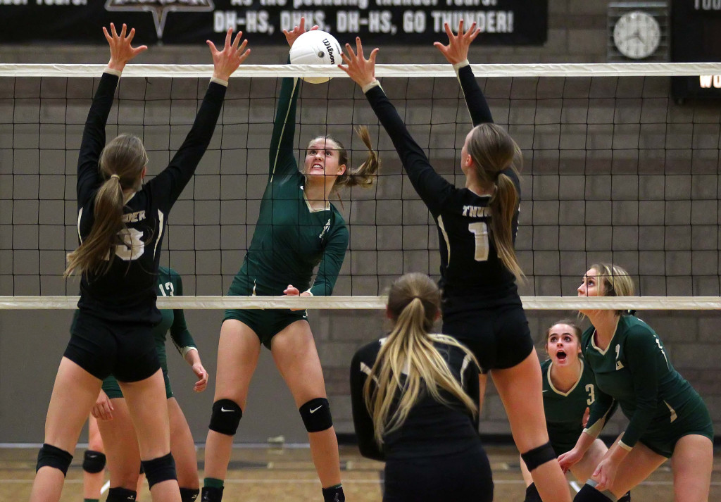 Camryn Johnson hits for Snow Canyon, Desert Hills vs. Snow Canyon, Volleyball, St. George, Utah, Oct. 13, 2015, | Photo by Robert Hoppie, ASPpix.com, St. George News