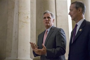 In this file photo, House Majority Leader Kevin McCarthy of Calif., left, walks on Capitol Hill in Washington. McCarthy says he regrets comments suggesting the House special committee on Benghazi has political goals. McCarthy says he never intended to make that suggestion. He says the purpose of the committee is to find out the truth and it has nothing to do with politics, Washington, Sept. 30, 2015 | AP File Photo by Andrew Harnik, St. George News