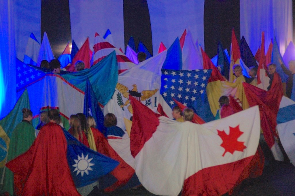 In this file photo from the 2014 Huntsman World Senior Games, flags of the countries represented are presented at the opening ceremonies, St. George, Utah, Oct. 7, 2014 | Photo by Hollie Reina, St. George News