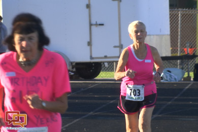 World Record Holder, 90-year-old Dottie Gray runs along the track during the 1,500 meter run event at the 2015 Huntsman Senior Games, St. George, Utah, Oct. 7, 2015   Photo by Devan Chavez, St. George News