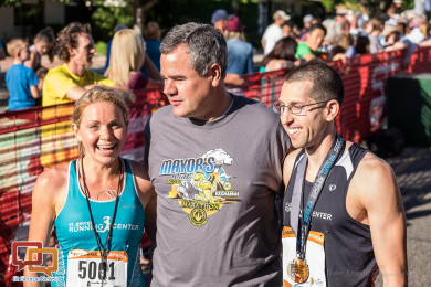 First place finishers Aaron Metler (r) and Amber Green (l) pose with St. George Mayor Jon Pike after completing the St. George Marathon, St. George, Utah, Oct. 3, 2015 | Photo by Dave Amodt, St. George News