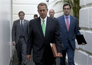 House Speaker John Boehner of Ohio arrives for a caucus meeting on Capitol Hill. Rep. Paul Ryan, R-Wis. is seeking unity in a place it's rarely found, telling House Republicans he will serve as their speaker only if they embrace him by week's end as their consensus candidate. Washington, D.C., Oct. 21, 2015 | AP Photo by Carolyn Kaster, St. George News